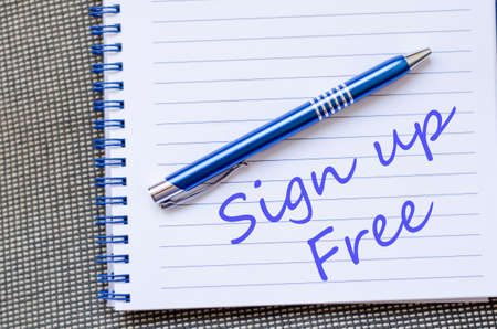 join here: Notepad and pen on wooden background and text concept