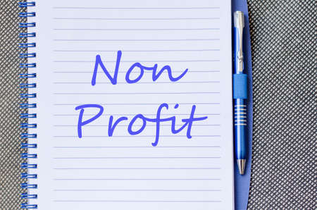 non: Blue notepad and Non profit text concept Stock Photo