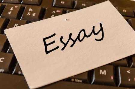 essay: Essay text concept note on dark keyboard background
