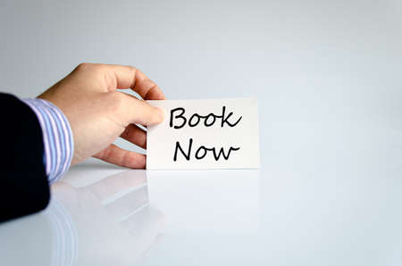 book concept: Book now text concept isolated over white background Stock Photo