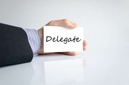 to designate: Delegate text concept isolated over white background Stock Photo