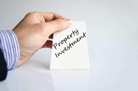 property investment: Property investment text concept isolated over white background Stock Photo