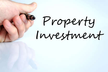 press agent: Property investment text concept isolated over white background Stock Photo