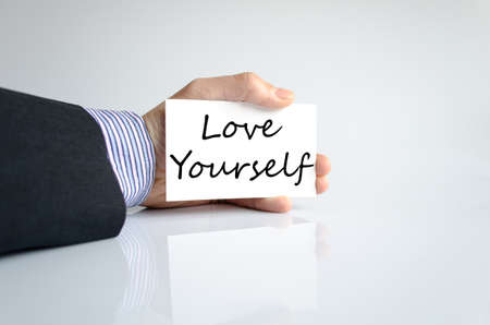 selfish: Love yourself text concept isolated over white background