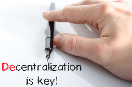 decentralization: Decentralization is key text concept isolated over white background