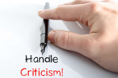 criticism: Handle criticism text concept isolated over white background Stock Photo