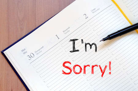 apologize: Im sorry text concept write on notebook