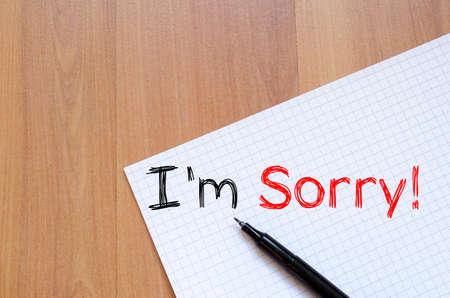 Lo siento concepto de escritura de texto en el cuaderno Foto de archivo - 46692229