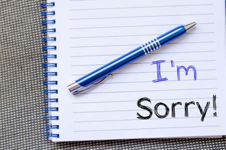I'm sorry text concept write on notebook