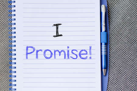 to commit: I promise text concept write on notebook