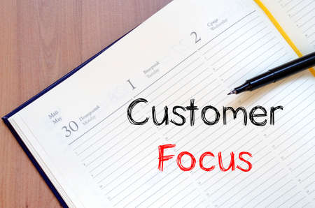 customer focus: Customer focus text concept write on notebook Stock Photo