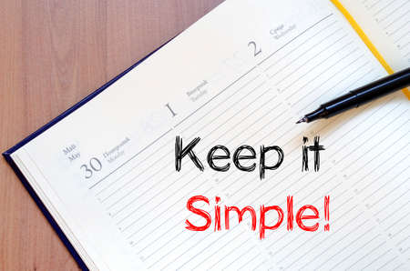 business life: Keep it simple text concept write on notebook Stock Photo