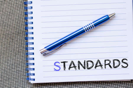 standards: Standards text concept write on notebook