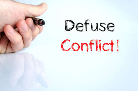 defuse: Defuse conflict text concept isolated over white background Stock Photo