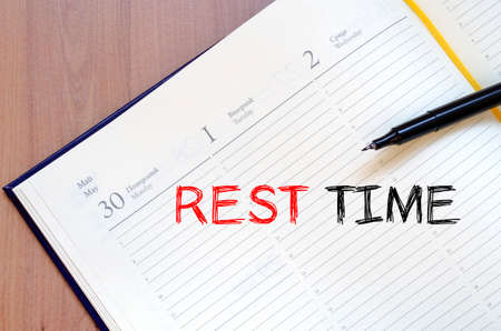 rest: Rest time text concept write on notebook Stock Photo