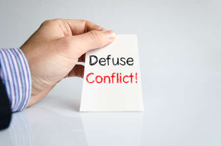 resolved: Defuse conflict text concept isolated over white background Stock Photo