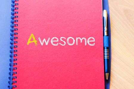 commend: Awesome text concept write on notebook