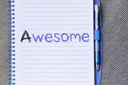 acclaim: Awesome text concept write on notebook