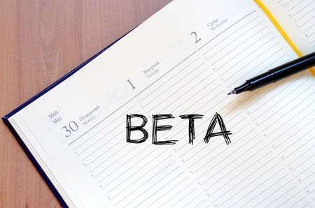 beta: Beta text concept write on notebook