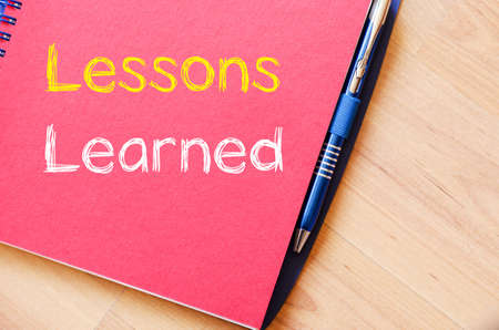 Lessons learned text concept write on notebook