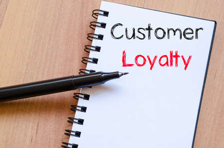 adwords: Customer loyalty text concept write on notebook Stock Photo
