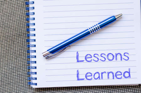 learned: Lessons learned text concept write on notebook