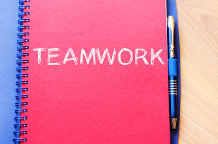 combined effort: Teamwork text concept write on notebook with pen Stock Photo