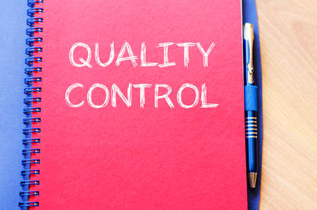 pen quality: Quality control text concept write on notebook with pen