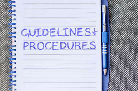 categorized: Guidelines and procedures text concept write on notebook with pen