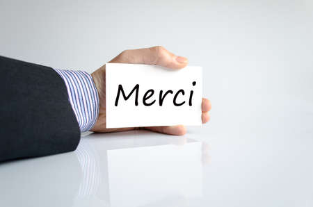 thankfulness: Merci text concept isolated over white background Stock Photo