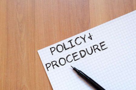 Policy and procedure text concept write on notebook with pen Banque d'images