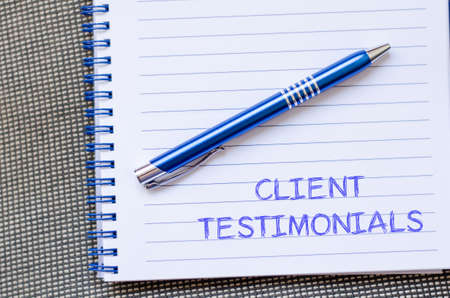 Client testimonials text concept write on notebook with pen
