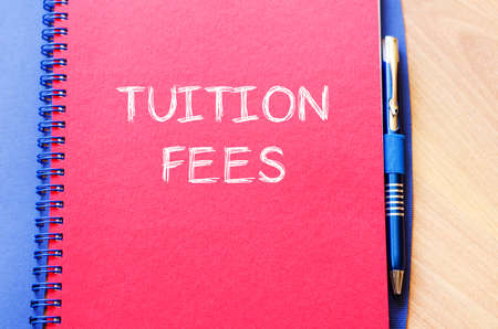 conservative: Tuition fees text concept write on notebook with pen Stock Photo