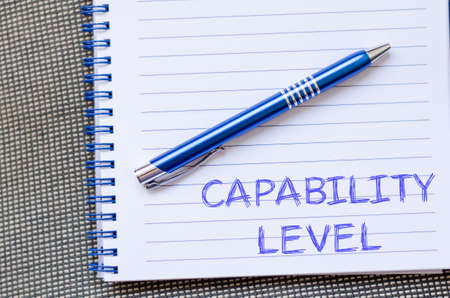 Capability level text concept write on notebook with pen