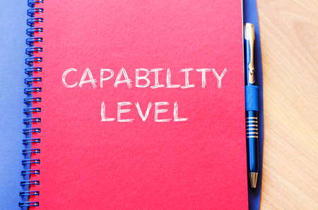 capability: Capability level text concept write on notebook with pen