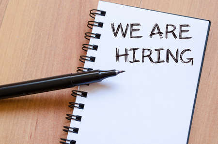 new recruit: We are hiring text concept write on notebook