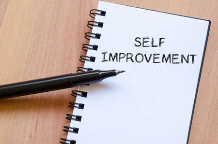define: Self improvement text concept write on notebook with pen Stock Photo