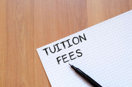 Tuition fees text concept write on notebook with pen Stock Photo