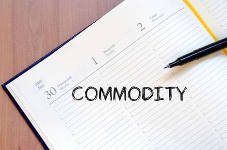 commodity: Commodity text concept write on notebook with pen