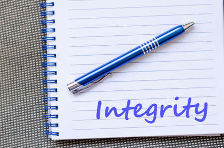 Integrity text concept write on notebook with pen