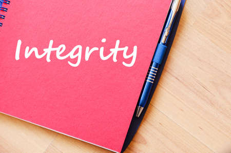 normative: Integrity text concept write on notebook with pen