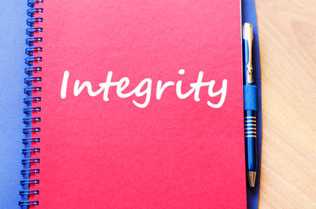 concession: Integrity text concept write on notebook with pen