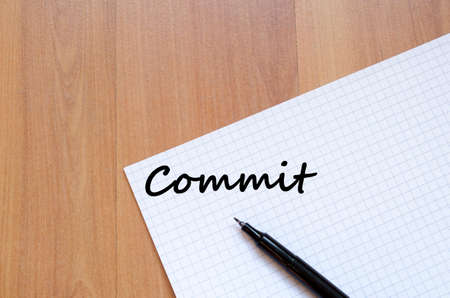 commit: Commit text concept write on notebook with pen