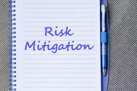 mitigation: Risk mitigation text concept write on notebook with pen Stock Photo