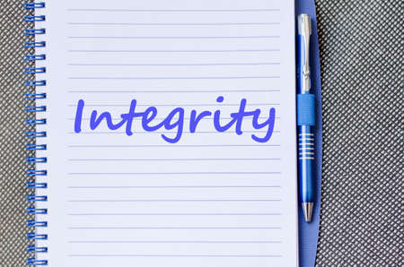 uprightness: Integrity text concept write on notebook with pen