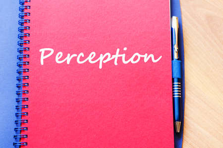 perceived: Perception text concept write on notebook with pen