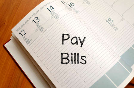 dispense: Pay bills text concept write on notebook