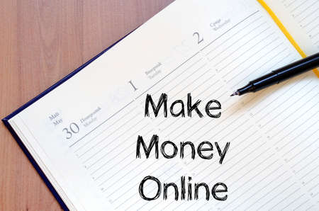 adwords: Make money online text concept write on notebook with pen