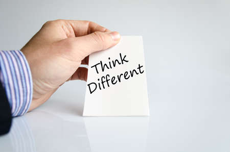 differently: Think different text concept isolated over white background Stock Photo