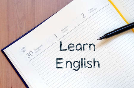 english text: Learn english text concept write on notebook with pen Stock Photo